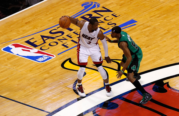 Dwyane Wade #3 of the Miami Heat looks to move the ball in the first half against Keyon Dooling #51