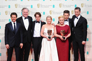 Tom Cruise, Jonathan Sehring, Cathleen Sutherland, Ellar Coltrane, Ethan Hawke, Patricia Arquette and John Sloss celebrate Best Film 'Boyhood' in the winners room at the EE British Academy Film Awards at The Royal Opera House on February 8, 2015 in London, England.