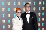 Sandy Powell (L) and Christopher Peterson attend the EE British Academy Film Awards 2020 at Royal Albert Hall on February 02, 2020 in London, England.