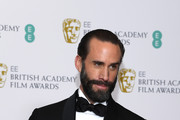 Joseph Fiennes poses in the press room during the EE British Academy Film Awards at Royal Albert Hall on February 10, 2019 in London, England.