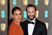 Joseph Fiennes (R) and Maria Dolores Dieguez attend the EE British Academy Film Awards at Royal Albert Hall on February 10, 2019 in London, England.