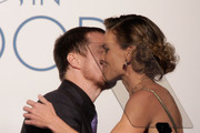 Actor Sam Rockwell (L) and honoree Hilary swank seen onstage at ELLE's 17th Annual Women in Hollywood Tribute at The Four Seasons Hotel on October 18, 2010 in Beverly Hills, California.