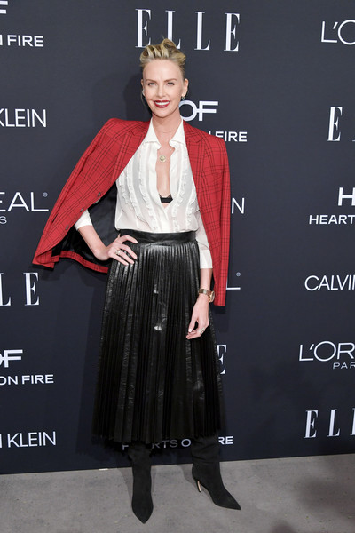 Charlize Theron arrived for the 2018 Elle Women in Hollywood celebration wearing a red plaid blazer by Dior.