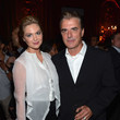She parties with Chris Noth.