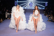 Constance Jablonski and Joan Smalls walk the runway during the ETAM  show as part of the Paris Fashion Week Womenswear Spring/Summer 2019 on September 25, 2018 in Paris, France.