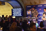 Music artists Biz Markie and DJ Cool V perform at EW & CNN The Eighties Trivia Event at The Django at the Roxy Hotel on March 29, 2016 in New York City.