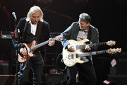 Guitarist Joe Walsh (L) of the Eagles performs with guitarist Steuart Smith at MGM Grand Garden Arena on September 27, 2019 in Las Vegas, Nevada.