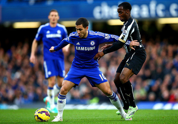Chelsea v Newcastle United - Premier League [player,sports,sports equipment,football player,team sport,ball game,soccer player,soccer,sport venue,football,vurnon anita,eden hazard,ball,chelsea,stamford bridge,england,newcastle united,premier league,battles,match]