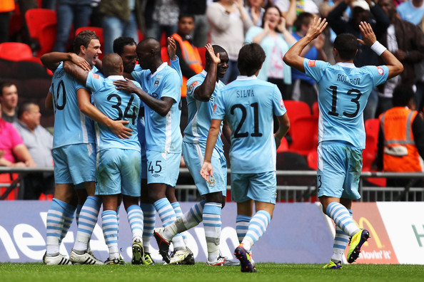 Manchester City v Manchester United - FA Community Shield [player,sports,team sport,ball game,sport venue,team,product,football player,sports equipment,tournament,fa community shield,edin dzeko,team mates,goal,side,wembley stadium,manchester city,manchester united,l,match]
