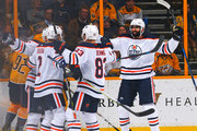 Andrej Sekera #2, Matthew Benning #83 and Jujhar Khaira #16 of the Edmonton Oilers celebrate a goal against  the Nashville Predators during the third period at Bridgestone Arena on January 9, 2018 in Nashville, Tennessee. The goal was later waved off due to an offsides play.