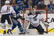 Goalie Cam Talbot #33 of the Edmonton Oilers stops Jussi Jokinen #36 of the Vancouver Canucks in close while Adam Larsson #36 tries to help defend in NHL action on March, 29, 2018 at Rogers Arena in Vancouver, British Columbia, Canada.