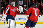 Goalie Braden Holtby #70 of the Washington Capitals and teammate Alex Ovechkin #8 celebrate after defeating the Edmonton Oilers, 1-0, at Verizon Center on November 23, 2015 in Washington, DC.