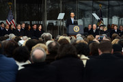 U.S. President Barack Obama speaks during the Edward M. Kennedy Institute Dedication Ceremony as (L to R) Trent Lott, Tom Daschle, Edward Kennedy Jr., First Lady Michelle Obama, Boston Mayor Marty Walsh, U.S. Senator Edward Markey, U.S. Vice President Joe Biden, Cardinal Sean O'Malley, Jean Kennedy Smith, and Patrick Kennedy listen March 30, 2015 in Boston, Massachusetts. The Edward Kennedy Institute is a testament to one of the longest serving U.S. Senators.