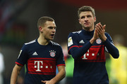 Joshua Kimmich and Thomas Mueller of Muenchen celebrate with the fans after the Bundesliga match between Eintracht Frankfurt and FC Bayern Muenchen at Commerzbank-Arena on December 9, 2017 in Frankfurt am Main, Germany.  (Photo by Alex Grimm/Bongarts/Getty Images) *** Local Caption *** Joshua Kimmich; Thomas Mueller
