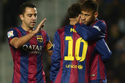 Lionel Messi of Barcelona celebrate scoring with his teammates Neymar JR (R) and Xavi (L) during the La Liga match between Elche FC and FC Barcelona at Estadio Manuel Martinez Valero on January 24, 2015 in Elche, Spain.