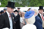 Prince William, Duke of Cambridge greets guests attending a garden party at Buckingham Palace on May 24, 2016 in London, England.