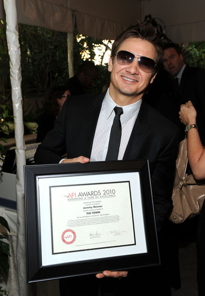 "Actor Jeremy Renner poses with ""Year of Excellence"" Award for ""The Town"" at the Eleventh Annual AFI Awards presentation at the Four Seasons Hotel on January 14, 2011 in Los Angeles, California."