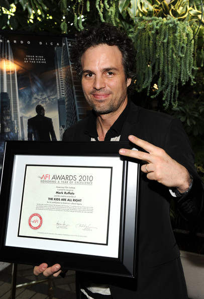 "Actor Mark Ruffalo  poses with ""Year of Excellence"" award for ""The Kids Are All Right"" at the Eleventh Annual AFI Awards presentation at the Four Seasons Hotel on January 14, 2011 in Los Angeles, California."