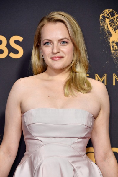 69th Annual Primetime Emmy Awards - Arrivals [hair,blond,beauty,human hair color,hairstyle,fashion model,shoulder,girl,long hair,brown hair,arrivals,elisabeth moss,microsoft theater,los angeles,california,primetime emmy awards]