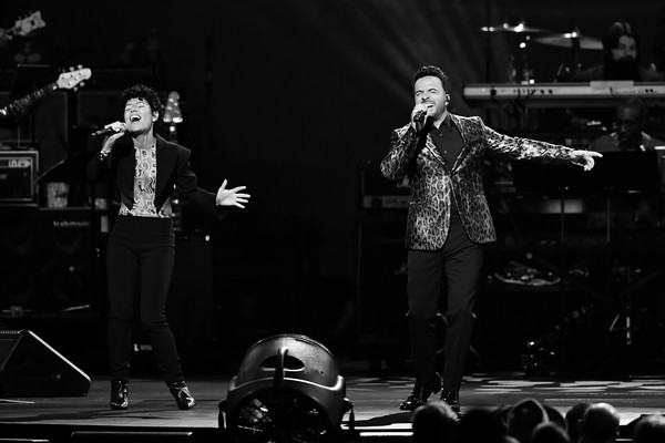 2020 MusiCares Person Of The Year Honoring Aerosmith - Show [musicares person of the year,image,performance,entertainment,black,performing arts,music,black-and-white,event,music artist,monochrome,stage,luis fonsi,emily king,l-r,los angeles convention center,california,west hall,aerosmith,honoring aerosmith - show,luis fonsi,photography,musician,singer-songwriter,stock photography,image,getty images,royalty-free,aerosmith]