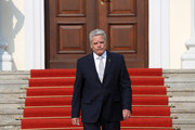German President Joachim Gauck walks outside of Bellevue Palace to meet Sheikh Tamim bin Hamad Al Thani, the eighth and current Emir of the State of Qatar (not pictured) at Bellevue Palace on September 17, 2014 in Berlin, Germany. The Qatari monarch, known for his support of sporting events and his position as head of the Qatar Investment Authority board of directors, is visiting Berlin and Bavaria on his trip to the country.