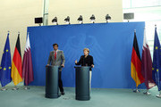 Sheikh Tamim bin Hamad Al Thani, the eighth and current Emir of the State of Qatar (L), listens during a press conference with German Chancellor Angela Merkel on September 17, 2014 in Berlin, Germany. The Qatari monarch, known for his support of sporting events and his position as head of the Qatar Investment Authority board of directors, is visiting Berlin and Bavaria on his trip to the country.