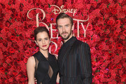 """Actors Emma Watson (L) and Dan Stevens pose backstage at the New York special screening of Disney's live-action adaptation """"Beauty and the Beast"""" at Alice Tully Hall on March 13, 2017 in New York City."""