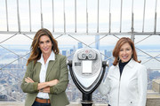 Cindy Crawford and Delivering Good President and CEO Lisa Gurwitch attend the Empire State Building in celebration of International Women's Day in partnership with Delivering Good and Jones New York on March 03, 2020 in New York City.