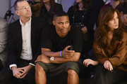 CEO of Barneys New York Mark Lee, basketball player Russell Westbrook and COO of Barneys New York Daniella Vitale attend the En Noir fashion show during Mercedes-Benz Fashion Week Spring 2015 at Pier 59 on September 11, 2014 in New York City.