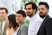 """(L-R) Director Xavier Dolan, Gabriel D'Almeida Freitas and Adib Alkhalidey attend the photocall for """"Matthias et Maxime (Matthias and Maxime)""""during the 72nd annual Cannes Film Festival on May 23, 2019 in Cannes, France."""