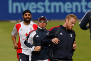 England players from (L-R) Monty Panesar, Ian Bell and Andrew Flintoff (R) warm up during England nets at Edgbaston on July 28, 2009 in Birmingham, England.