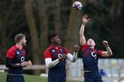 Mike Brown (R) attempts to catch the ball watched by Maro Itoje (C) and George Kruis during the England training session held at Pennyhill Park on February 23, 2016 in Bagshot, England.