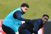 Deli Alli and Danny Welbeck take part in a drill during an England training session on the eve of their international friendly against the Netherlands at St Georges Park on March 22, 2018 in Burton-upon-Trent, England.