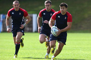 Ben Youngs runs with the ball with George Ford and Mike Brown (L) in support during the England training session at Pennyhill Park on September 14, 2015 in Bagshot, England.