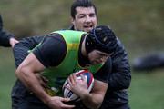 Flanker James Haskell is wrapped up by Hendre Fourie during the England Rugby Union squad training session at Pennyhill Park on February 10, 2011 in Bagshot, England.