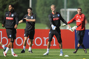 Arsenal youth goalkeeper James Shea trains alongside Gareth Barry, Joe Hart and Joleon Lescott during the England training session at London Colney on August 31, 2010 in St Albans, England.