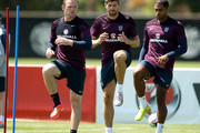 Wayne Rooney, Steven Gerrard and Glen Johnson in action during an England training session at the Barry University Campus on June 6, 2014 in Miami, Florida. England will play their final warm up match against Honduras on June 7th before travelling to Rio for the FIFA World Cup 2014 in Brazil.