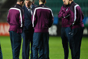 Manager Roy Hodgson of England talks to Wayne Rooney, Adam Lallana, Jonjo Shelvey and Jordan Henderson during the England Training and Press Conference at A Le Coq Arena on October 11, 2014 in Tallinn, Estonia.
