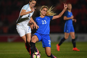 Kheira Hamraoui of France battles with Jill Scott of England during the International Friendly between England and France at Keepmoat Stadium on October 21, 2016 in Doncaster, England.