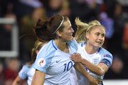 Jill Scott of England celebrates with Steph Houghton after scoring the equalizing goal during the UEFA Women's European Qualifer between England and Belgium at The New York Stadium on April 8, 2016 in Rotherham, England.