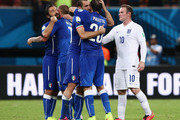Andrea Pirlo, Daniele De Rossi, Giorgio Chiellini and Gabriel Paletta of Italy celebrate defeating England 2-1 as Wayne Rooney of England looks on after the 2014 FIFA World Cup Brazil Group D match between England and Italy at Arena Amazonia on June 14, 2014 in Manaus, Brazil.