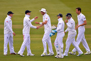 James Anderson (2nd L) of England is congratulated by (L-R) team mates Jonny Bairstow, Stuart Broad, Matt Prior, Joe Root and Steve Finn for taking 5 wickets during day three of the 1st Investec Test match between England and New Zealand at Lord's Cricket Ground on May 18, 2013 in London, England.