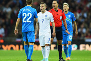 Jack Wilshere of England argues with Ales Mertelj of Slovenia during the EURO 2016 Qualifier Group E match between England and Slovenia at Wembley Stadium on November 15, 2014 in London, England.