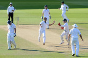 Imran Tahir of South Africa celebrates dismissing England captain Andrew Strauss during day four of the 1st Investec Test match between England and South Africa at The Kia Oval on July 22, 2012 in London, England.