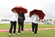 Umpires Rod Tucker (L) and Aleem Dar (R) shelter from the rain after inspecting the pitch with reserve umpire Neil Mallender during day two of the 3rd npower Test Match between England and Sri Lanka at the Rose Bowl on June 17, 2011 in Southampton, England.
