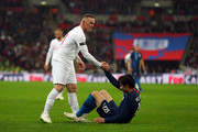 Wayne Rooney of England helps up Jorge Villafana of USA during the International Friendly match between England and United States at Wembley Stadium on November 15, 2018 in London, United Kingdom.