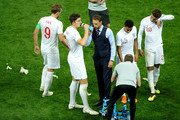 Gareth Southgate, Manager of England talks to Harry Maguire before extra time during the 2018 FIFA World Cup Russia Semi Final match between England and Croatia at Luzhniki Stadium on July 11, 2018 in Moscow, Russia.