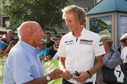 Sir Stirling Moss (L) talks to Brendon Hartley (R) at the finish area at the Ennstal Classic 2015 on July 17, 2015 in Schladming, Austria.
