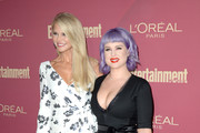 (L-R) Christie Brinkley and Kelly Osbourne attend the 2019 Pre-Emmy Party hosted by Entertainment Weekly and L'Oreal Paris at Sunset Tower Hotel in Los Angeles on Friday, September 20, 2019.