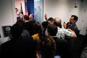 Reporters crowd the hallway trying to listen as House Majority Leader Eric Cantor (R-VA) speak during a news conference after telling the Republican caucus that he will resign his post at the U.S. Capitol June 11, 2014 in Washington, DC. Cantor announced that he will resign his leadership position in the House of Representatives on July 31 after losing a primary race to Tea Party-backed college professor David Brat.